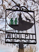 Woolpit Village Sign, Depicting the Green Children